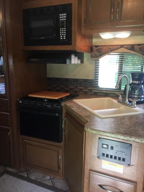 2013 Thor Chateau, 26 Ft. Class C Motorhome RV Rental Kitchen